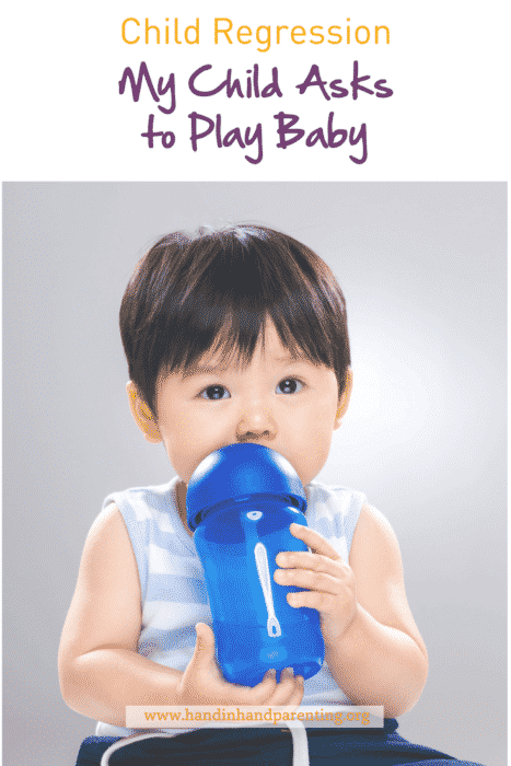 Boy holding baby bottle