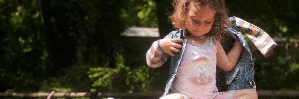 Preschool girl getting dressed