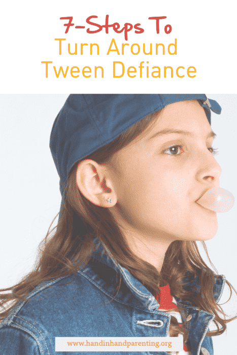 Tween girl blowing bubblegum